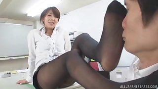 Office lassie in nylon stockings gives a footjob and gets fucked
