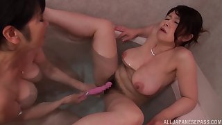 Mizuno Yoshie increased by her mature friend have kinky lesbian sex