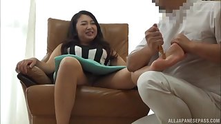 Mature Asian chubby brunette MILF gets a feet and pussy massage