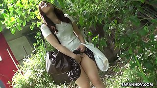 Yummy Japanese babe Eri Makino is pleasing her nasty pussy outdoor